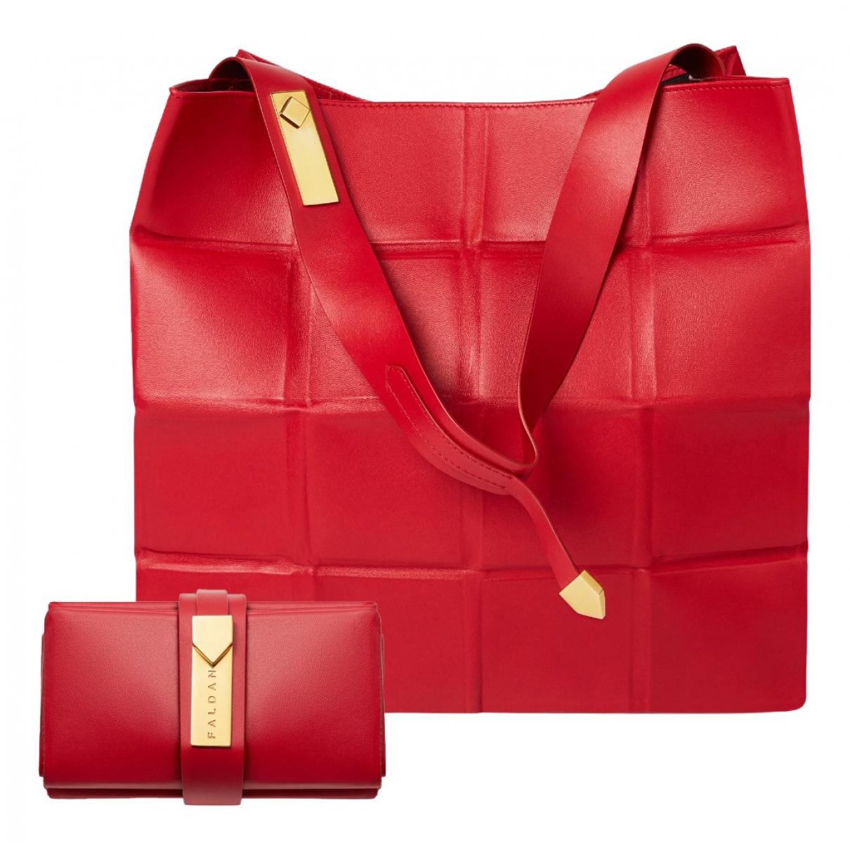 - Sac de voyage   pour femme en cuir - rouge