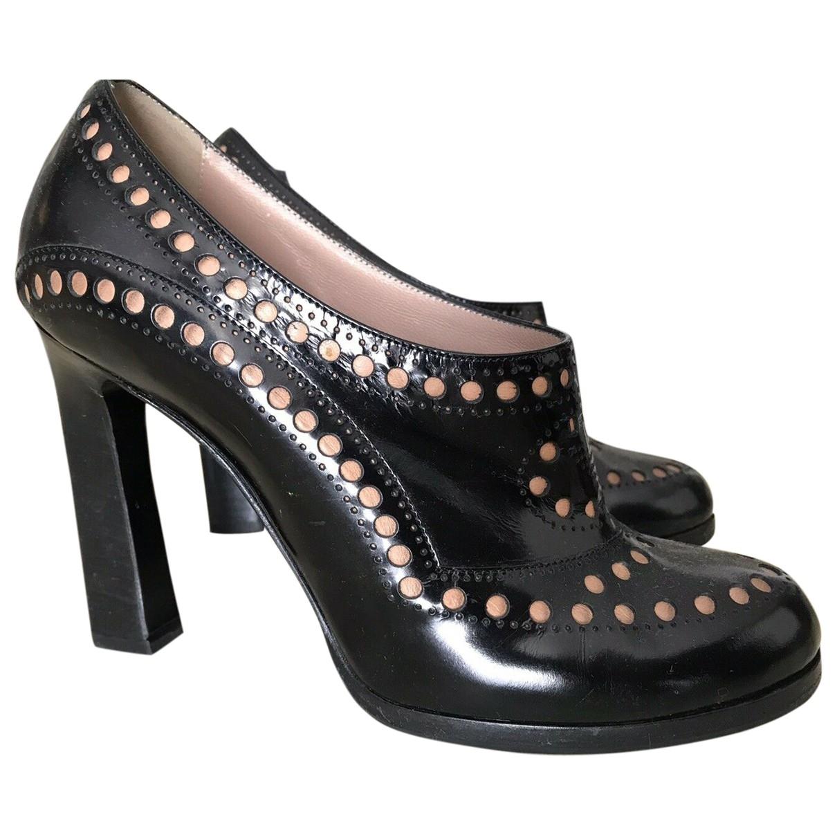 Emporio Armani - Boots   pour femme en cuir verni - noir