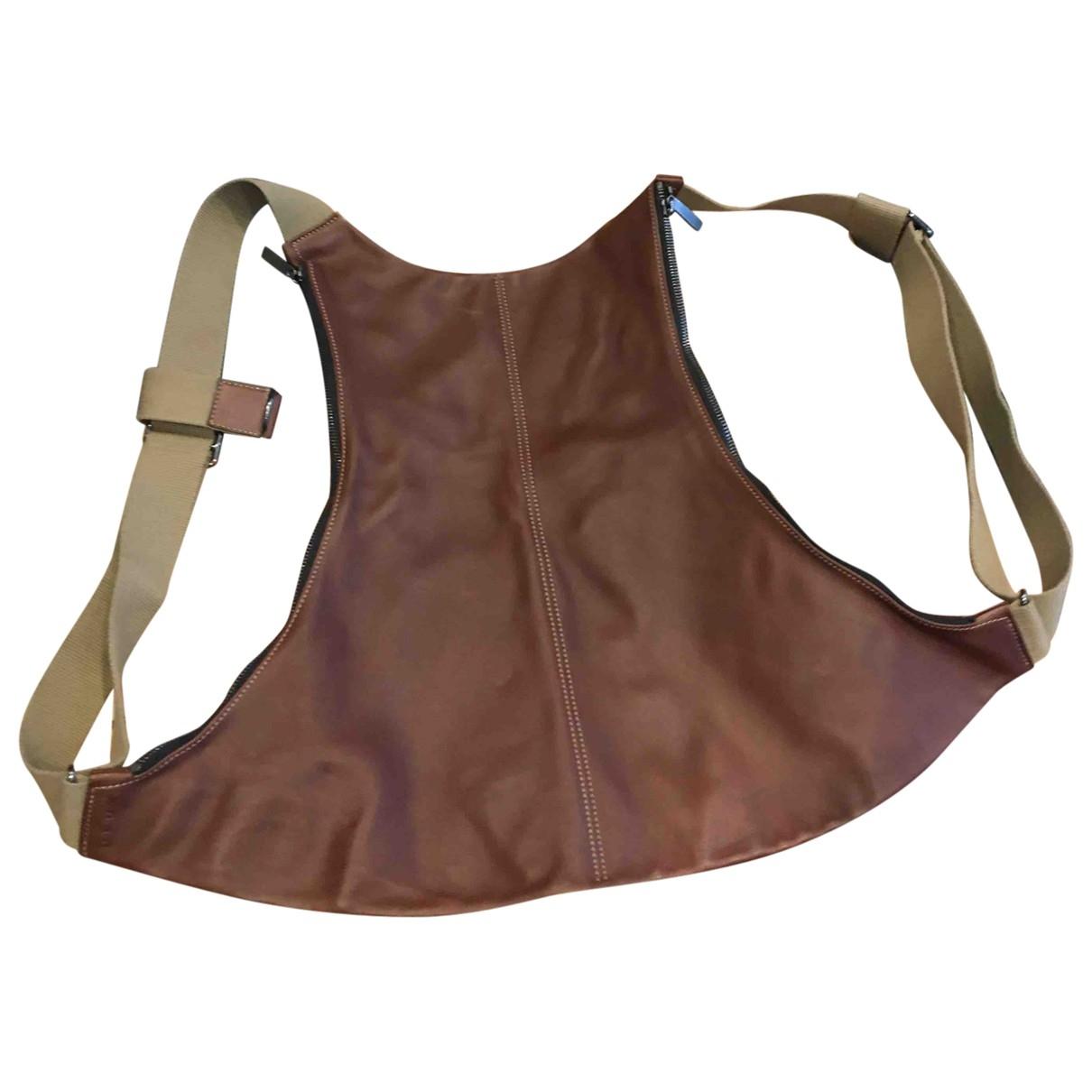 Delvaux - Sac a dos   pour femme en cuir - marron