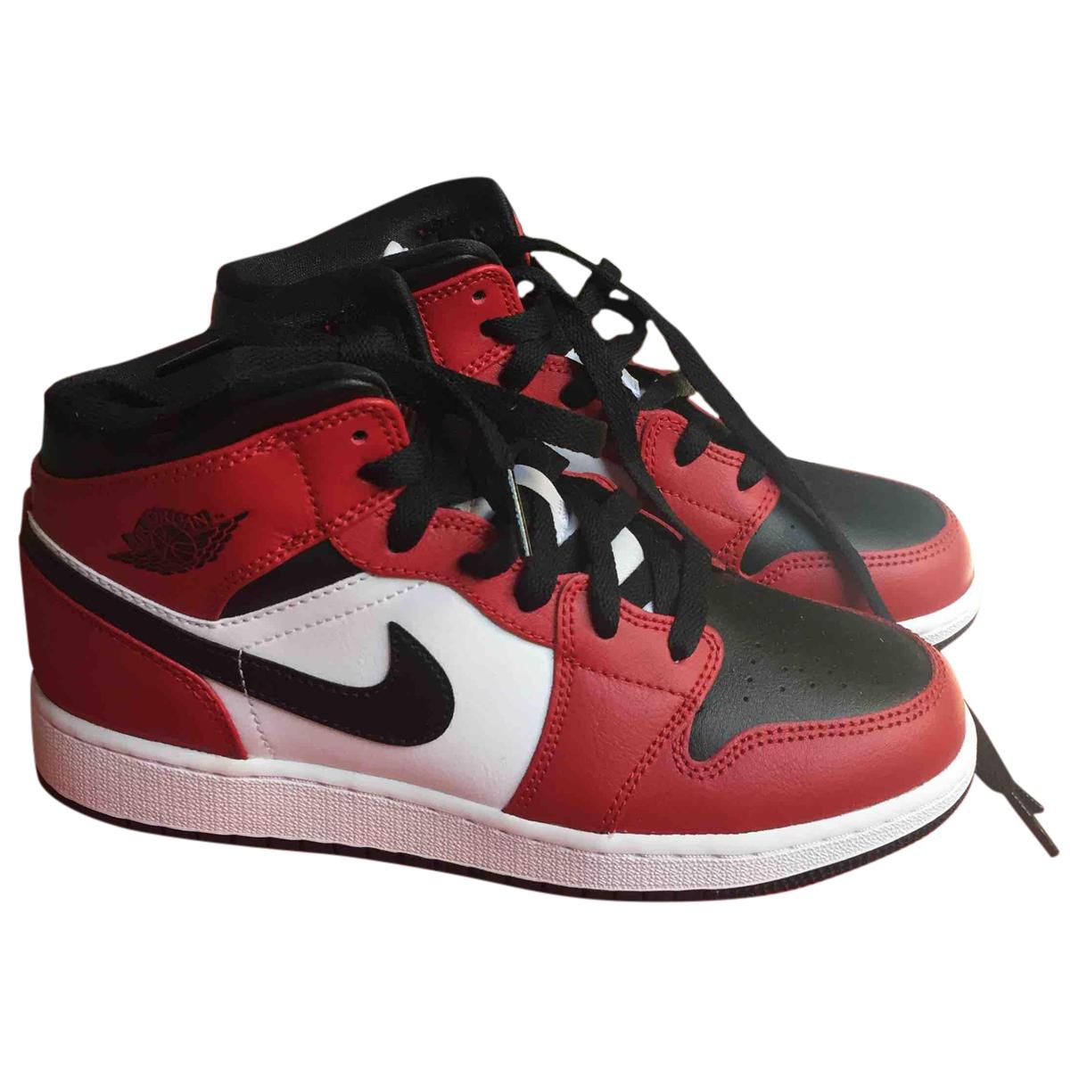 Jordan - Baskets Air Jordan 1  pour femme en cuir - rouge