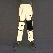 Reflektierende winddichte Jogginghose mit Buchstaben Grafik und Taschen Klappe