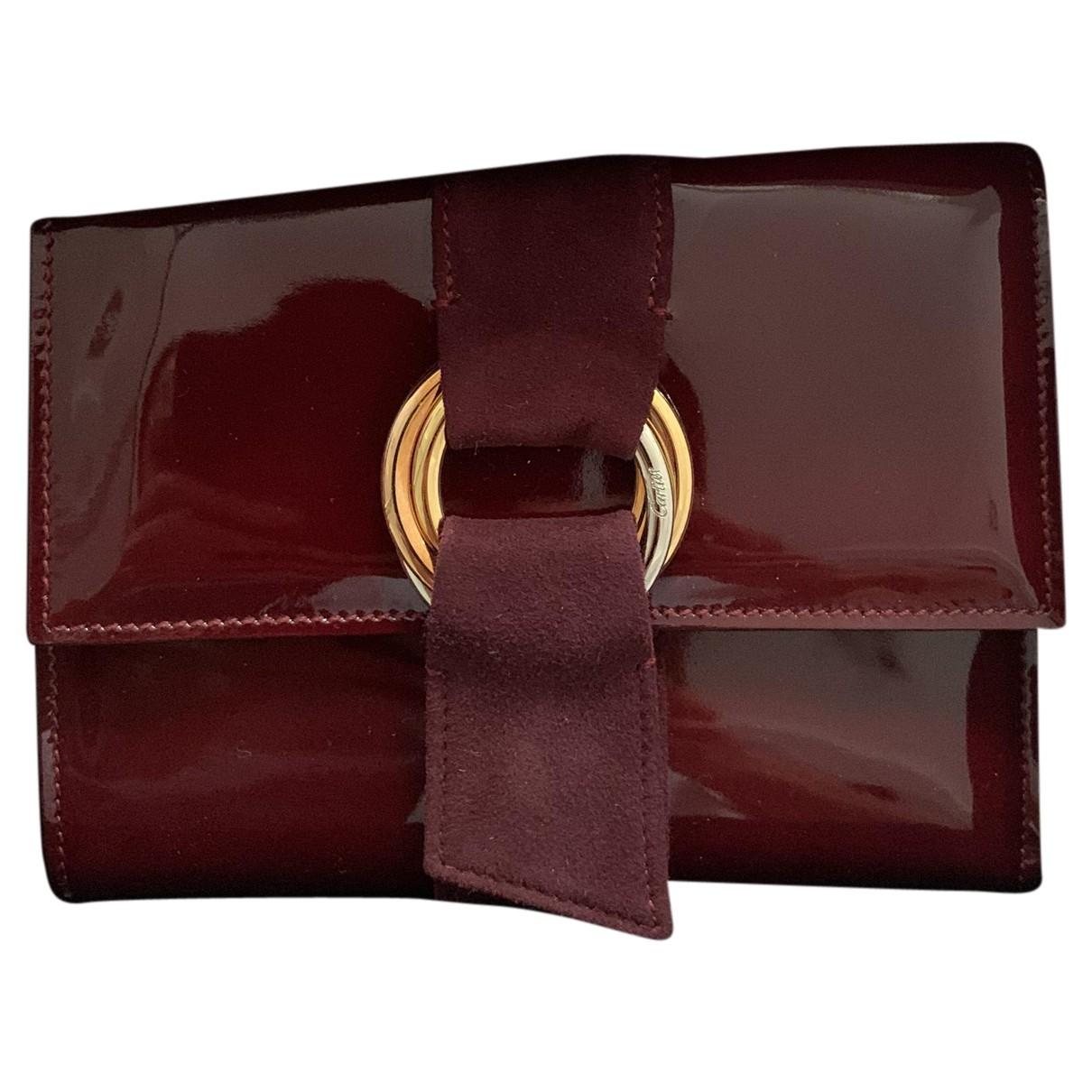 Cartier - Petite maroquinerie   pour femme en cuir verni - bordeaux