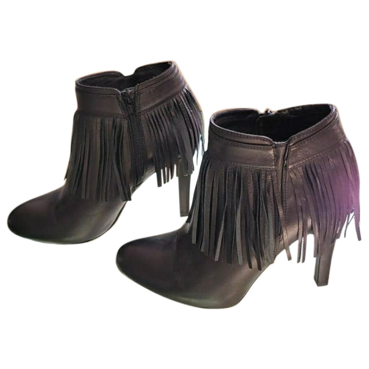 Unisa - Boots   pour femme en fourrure - noir