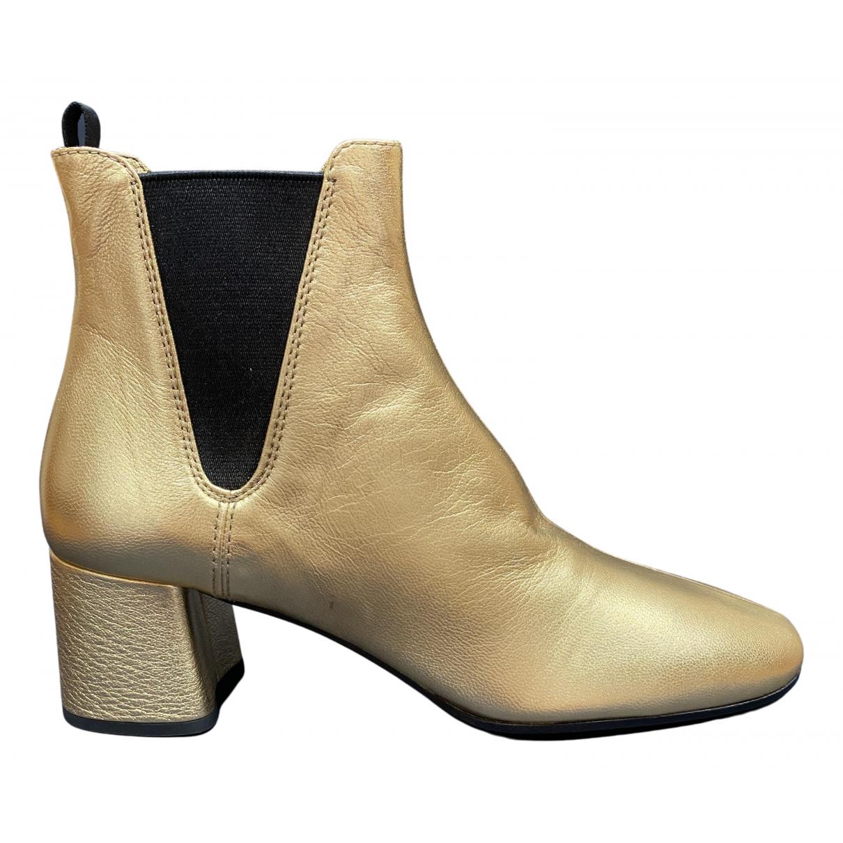 Prada \N Stiefeletten in  Gold Leder