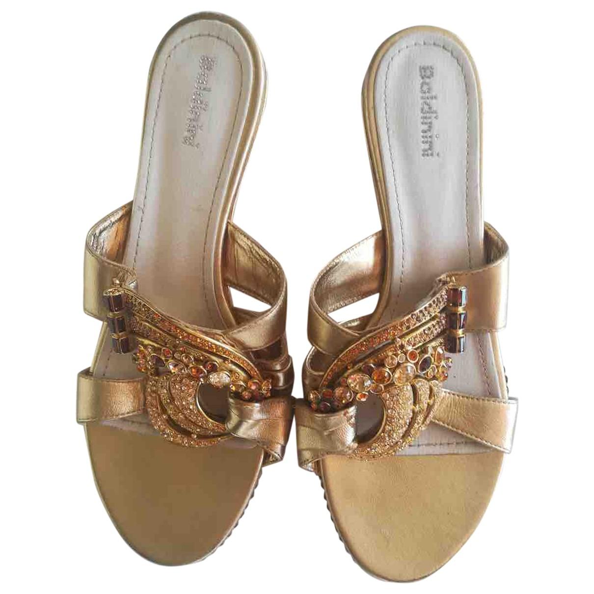 Baldinini - Sandales   pour femme en cuir - dore