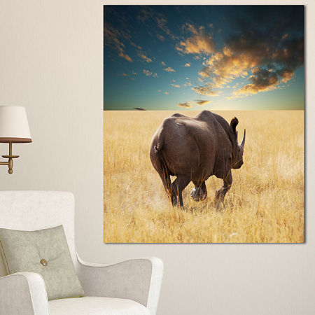 Designart Giant Rhino Under Cloudy Sky Extra LargeAfrican Canvas Art Print, One Size , Brown