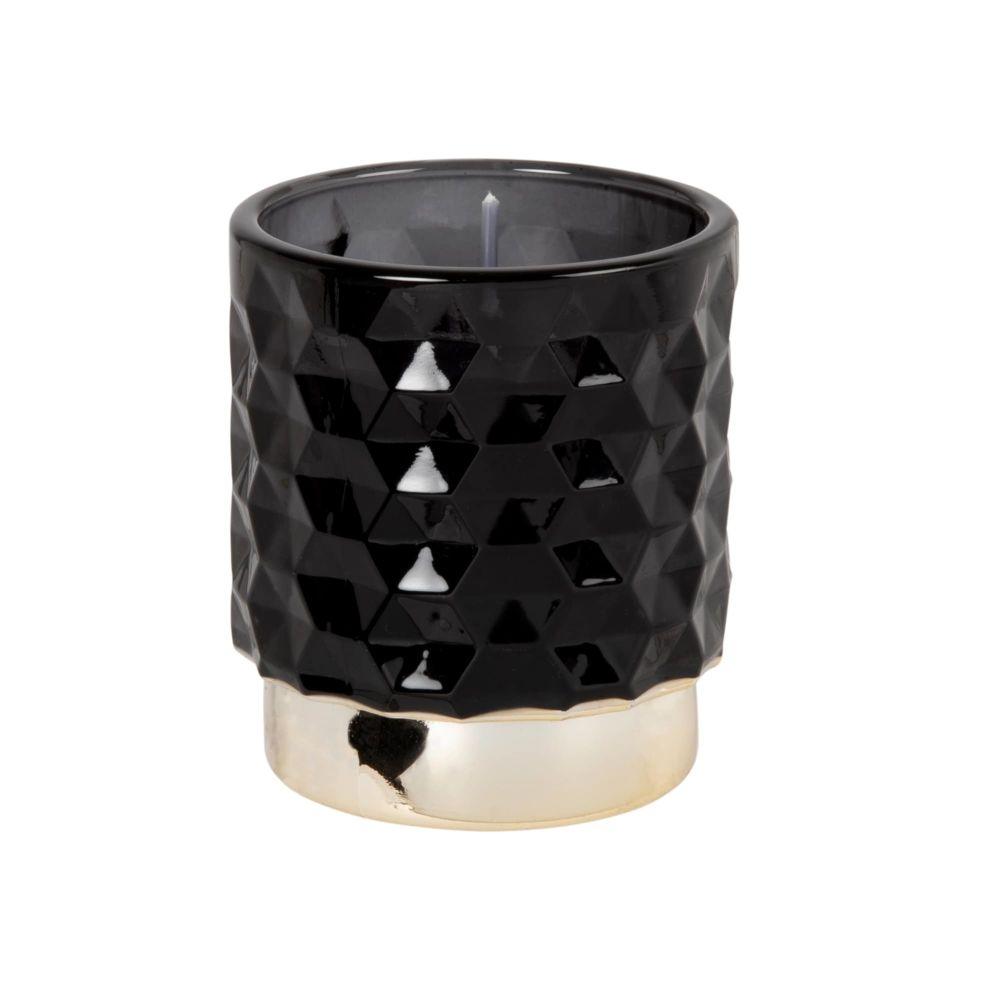 Kerze im gehaemmerten Glasgefaess, schwarz und goldfarben