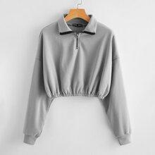 Crop Pullover mit Reissverschluss und halber Knopfleiste