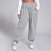 Jogginghose mit schraegen Taschen und elastischer Taille