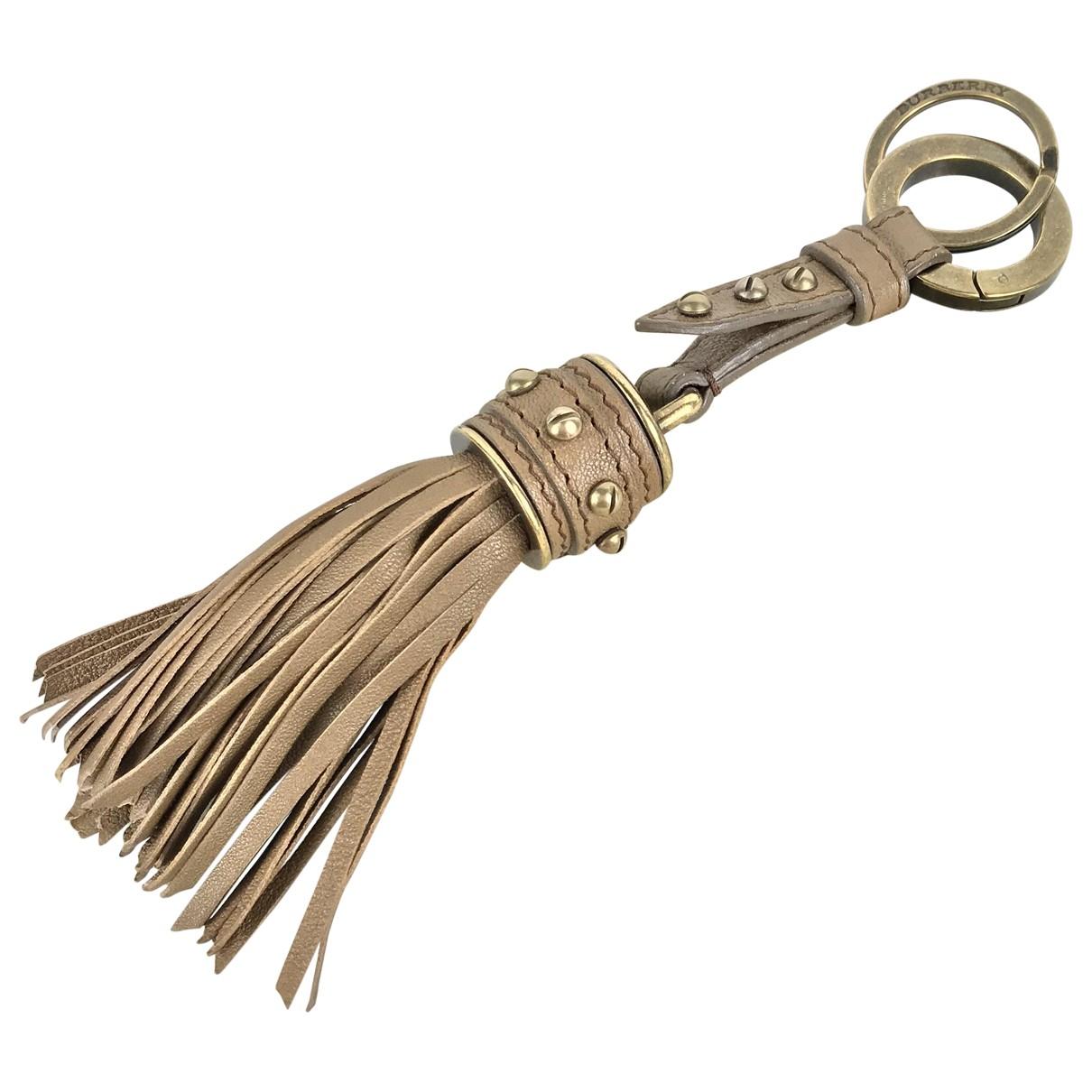 Burberry \N Beige Metal Bag charms for Women \N
