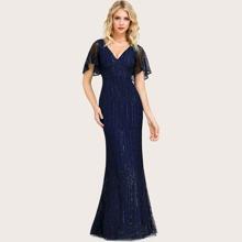 Kleid mit Glitzer, Netzstoff und Fischschwanz Design