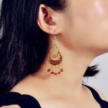 Ohrringe mit Perlen und Mond Dekor