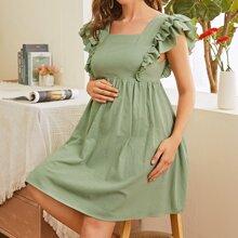 Umstandsmode Kleid mit quadratischem Kragen und Raffungsaum
