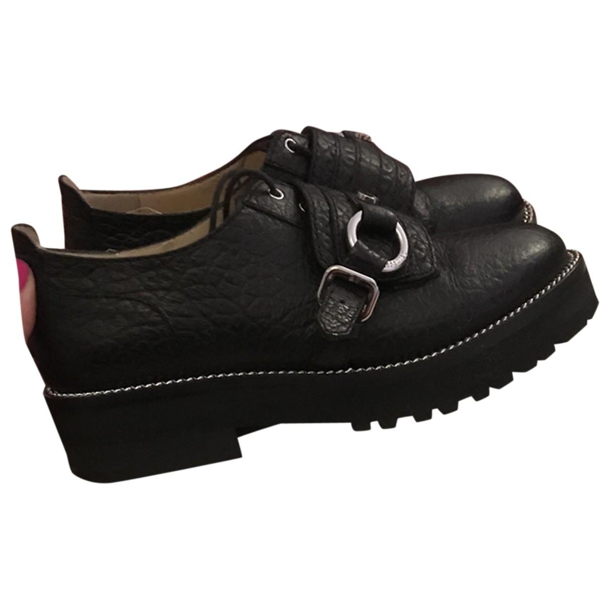 Moschino \N Schnuerschuhe in  Schwarz Leder