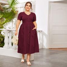 Kleid mit Knopfen vorn und doppelten Taschen