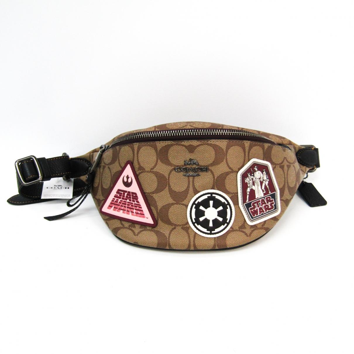 Coach \N Khaki Cloth Clutch bag for Women \N