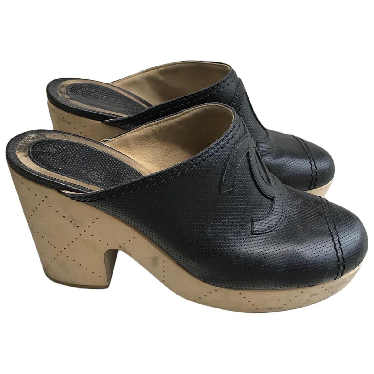 Chanel - Sabots   pour femme en cuir - noir