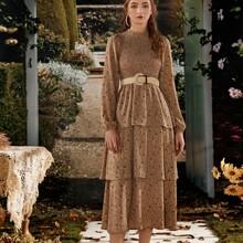 Kleid mit Gaensebluemchen Muster, Band und Guertel