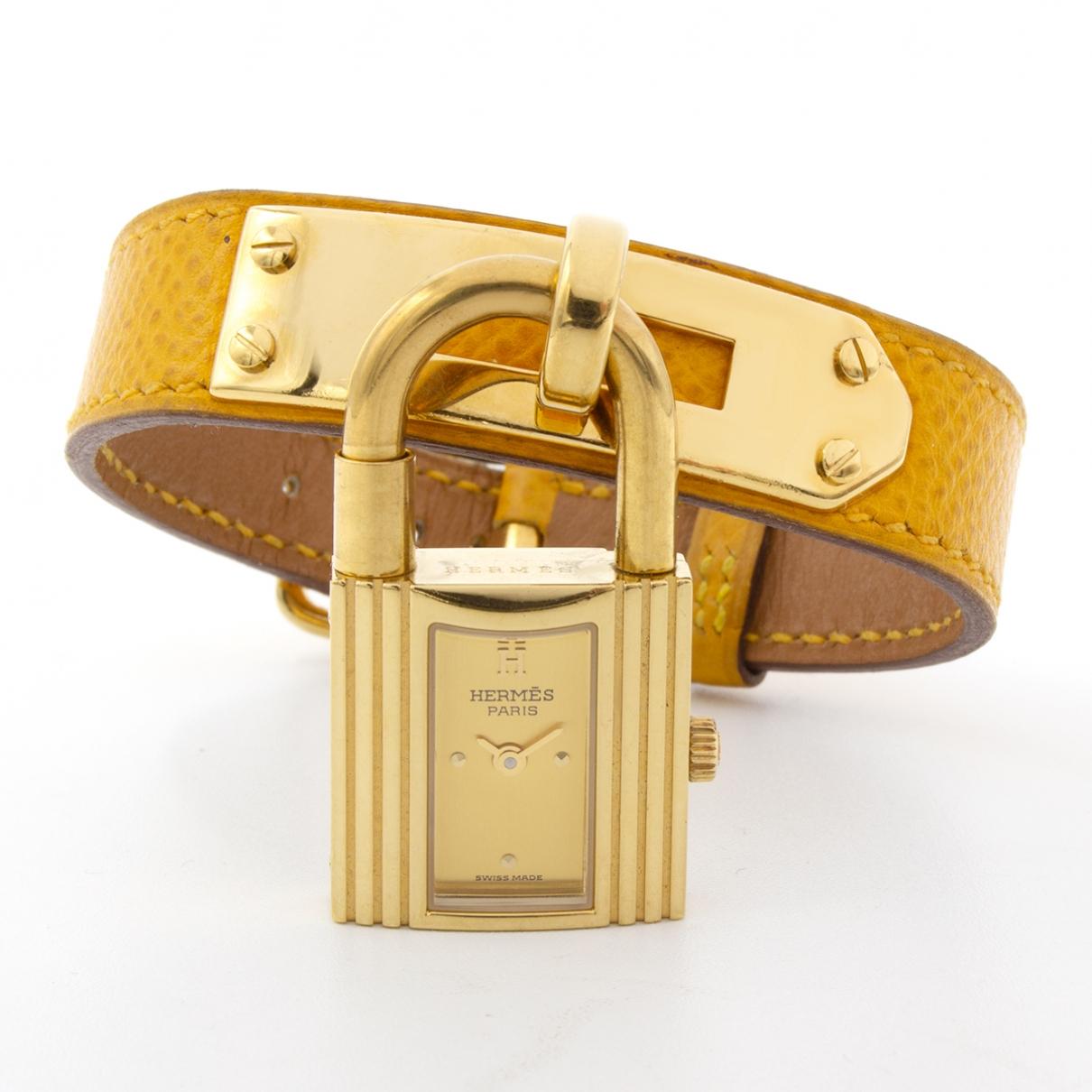 Hermes - Montre Kelly pour femme en plaque or - jaune