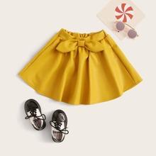 Falda de niñitas PU con lazo delantero unicolor