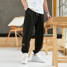 Pantalones deportivos de cintura con cordon con parche