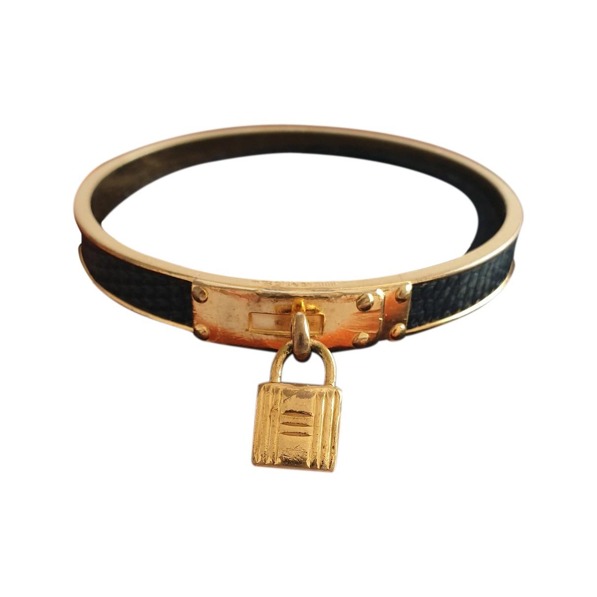 Hermes - Bracelet   pour femme en plaque or - dore