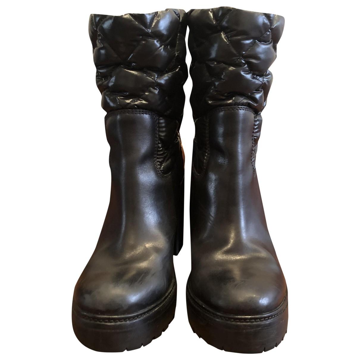 Moncler - Bottes   pour femme en cuir - noir