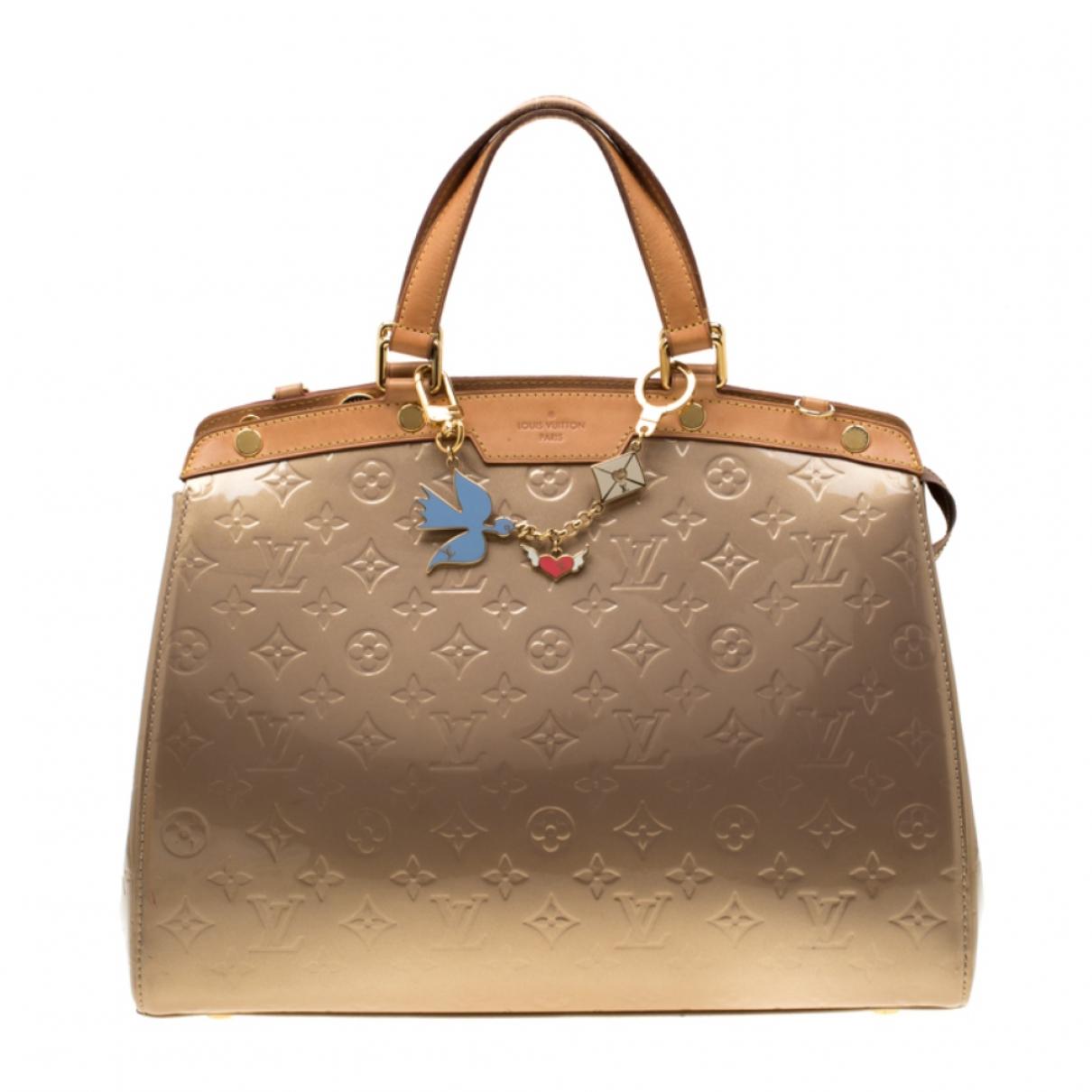 Louis Vuitton Brea Handtasche in  Beige Lackleder