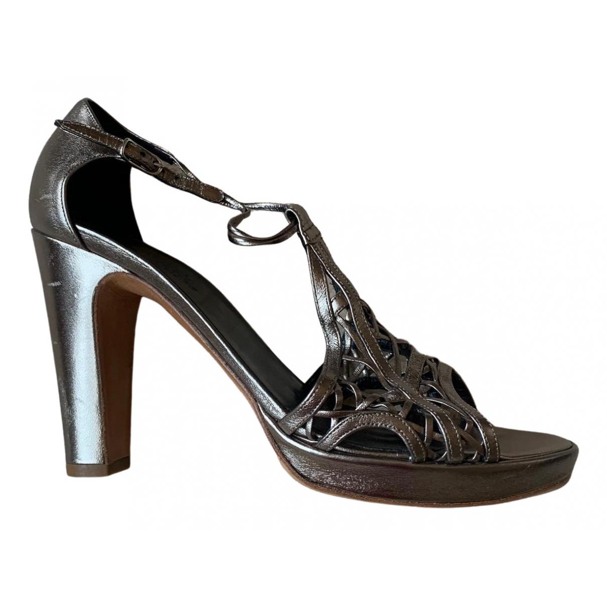Hermes \N Sandalen in  Metallic Leder