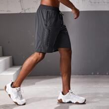 Shorts de hombres con cordon con estampado de letra