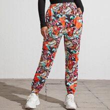 Jogginghose mit Pop Muster und schraegen Taschen