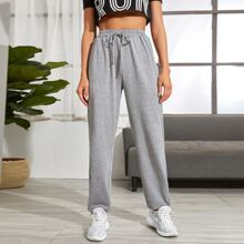 Pantalones deportivos con bolsillo lateral de cintura con cordon
