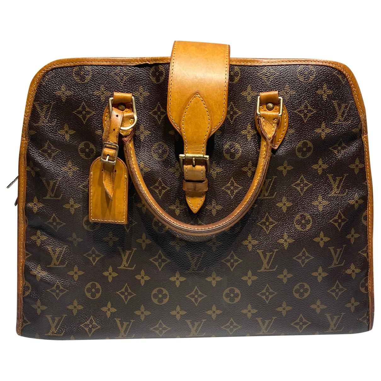 Bolso  Rivoli de Lona Louis Vuitton