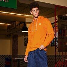 Neon orange Hoodie mit Flicken Detail und Taschen vorn