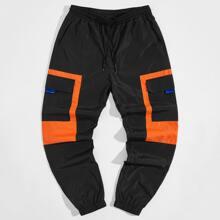 Pantalones viento panel neon con bolsillo con solapa de cintura con cordon