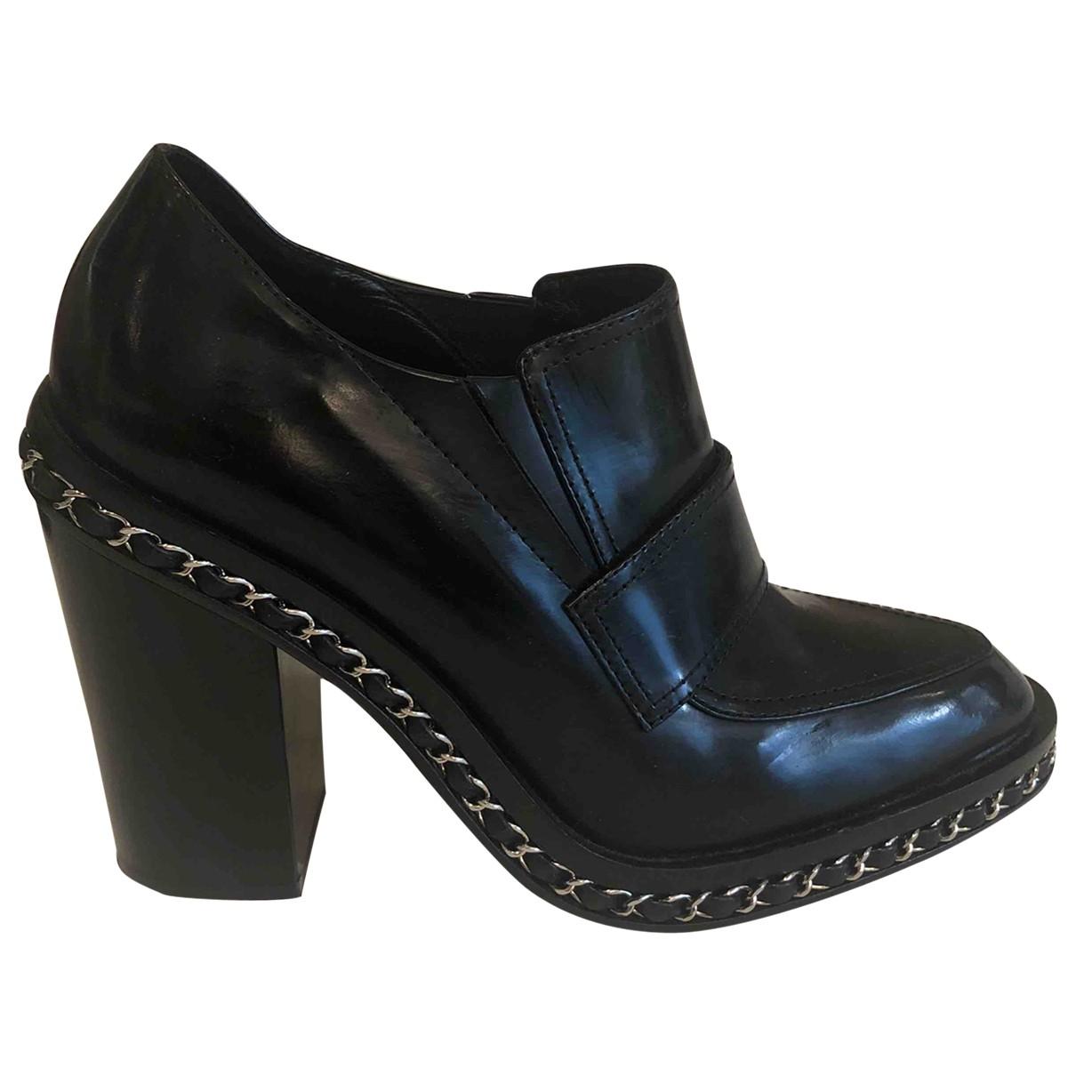 Chanel - Boots   pour femme en cuir - noir