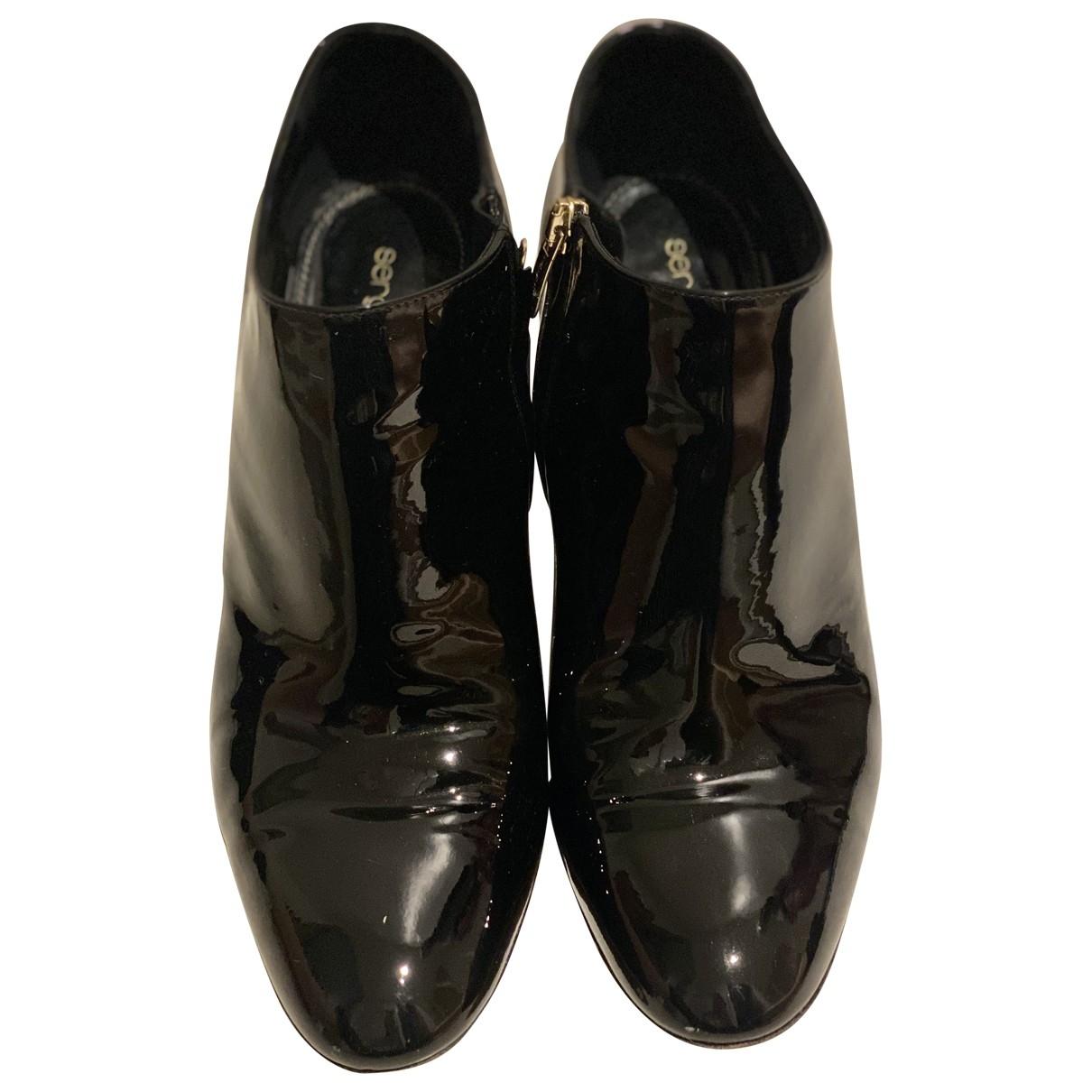 Sergio Rossi - Bottes   pour femme en cuir verni - noir
