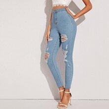 Schmale Jeans mit Rissen