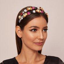 Aro de pelo metalico con decoracion de flores grabadas con piedras preciosas