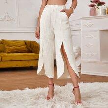 Pantalones tweed bajo con abertura