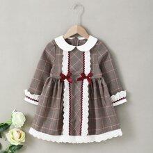 Kleid mit Hahnentritt Muster und Schleife