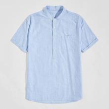 Camisa con bolsillo doblado