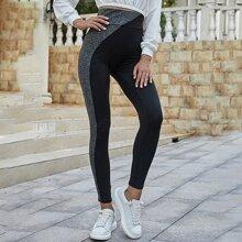 Zweifarbige Leggings mit breitem Taillenband