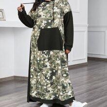 Kleid mit sehr tief angesetzter Schulterpartie, Taschen Flicken und Farbblock