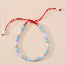 Armband mit bunten Perlen und Schnur