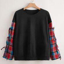 Sweatshirt mit Kontrast Karo Muster auf Ärmeln und seitlichen Knoten