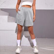 Shorts unicolor con bolsillo oblicuo de cintura elastica