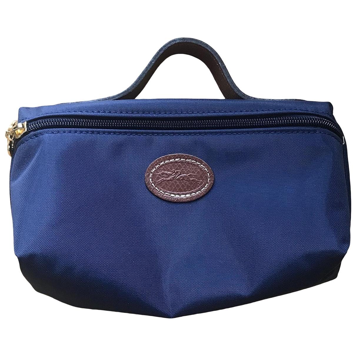 Longchamp - Sac de voyage   pour femme en toile - bleu