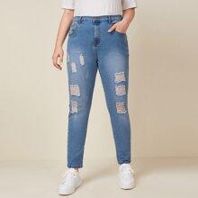 Skinny Jeans mit elastischer Taille, Bleichen Waschung und Riss