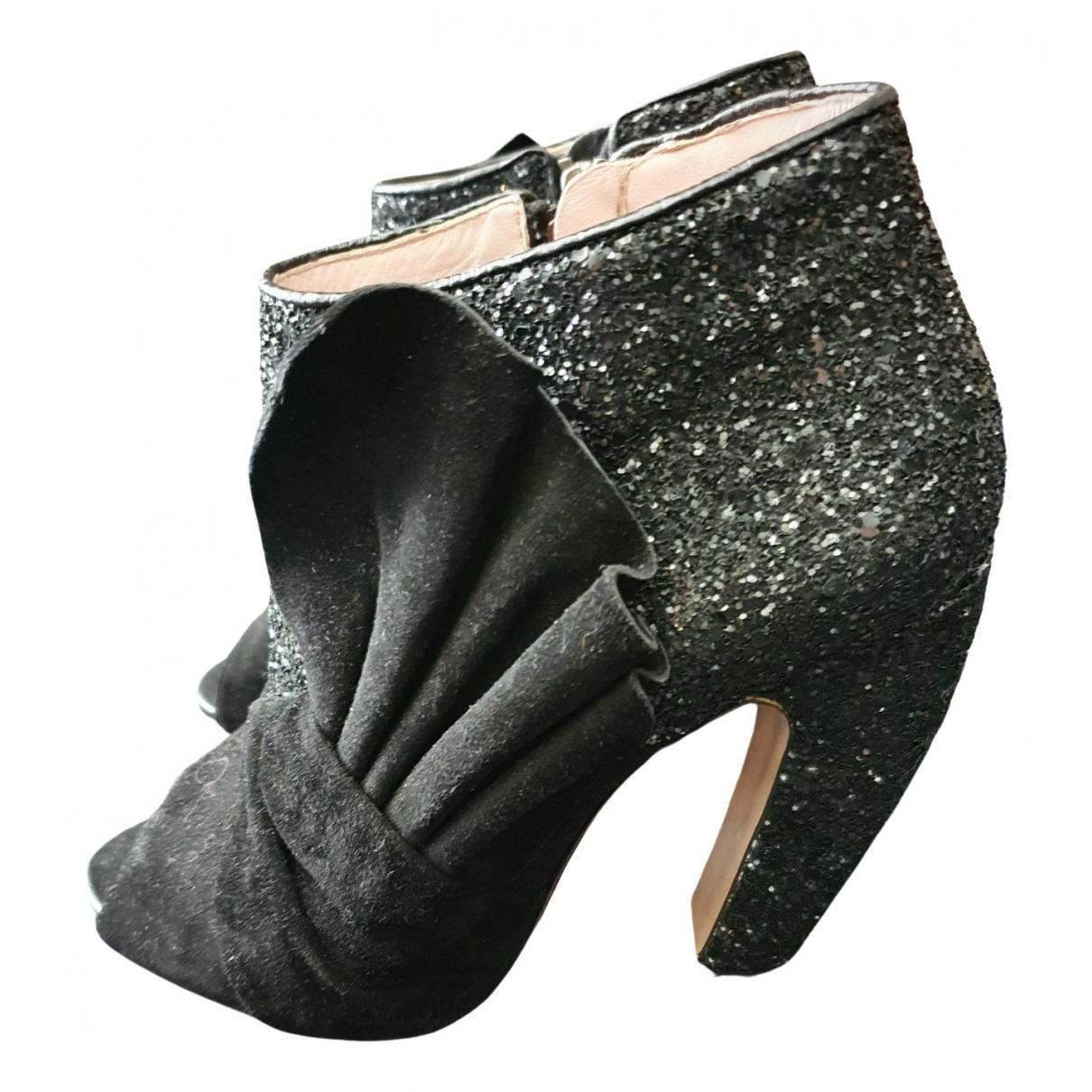 Miu Miu - Boots   pour femme en a paillettes - noir